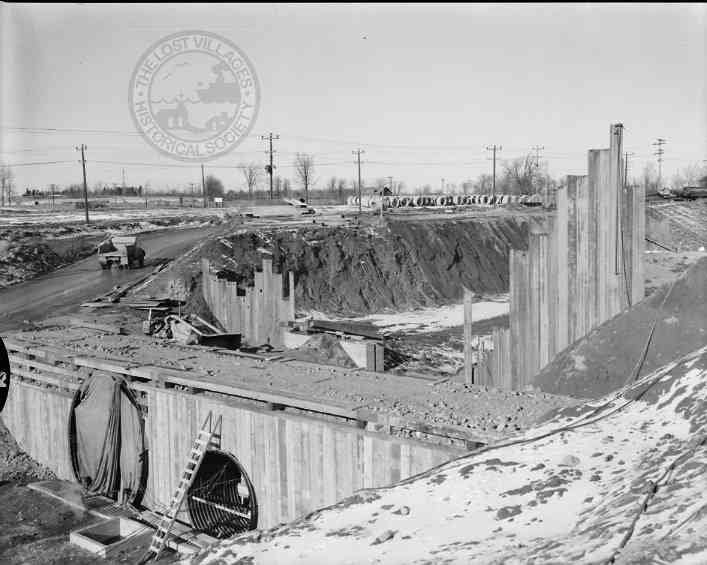 NEW ACCESS TUNNEL Before the new bypass canal was dug, a new access tunnel was constructed.  The first tunnel under the original canal was dug in the wintertime so as not to disrupt shipping. Anything too large for these portals went to Lock 19 where a retractable Bailey Bridge carried large pieces of machinery over the canal.