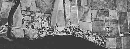 Old aerial photo of the village of Dickinson's Landing  circa late 1940s. On the left is Hoople's Creek, almost centered is Upper Wales rd., and Lower Wales rd. near the right side of the photo.