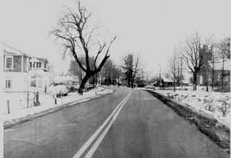 HWY #2 LOOKING WEST W. Fickes house on the left and St. Matthew's Church on the  right